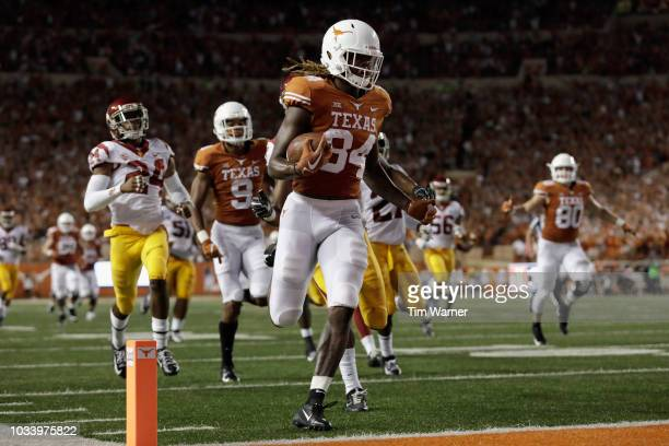 Lil'Jordan Humphrey of the Texas Longhorns catches a pass and runs for a touchdown in the second quarter defended by Marvell Tell III of the USC...