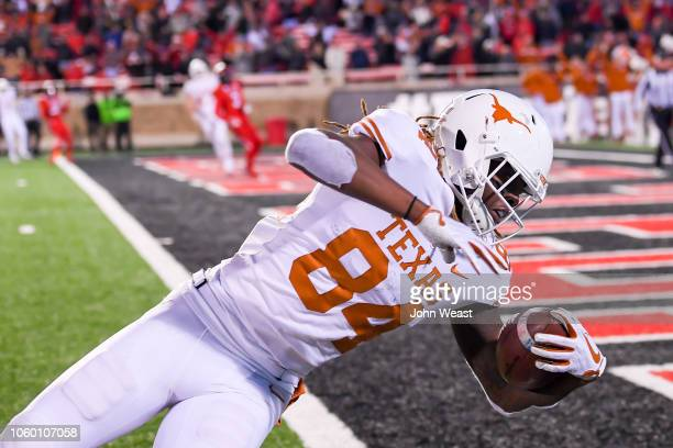 Lil'Jordan Humphrey of the Texas Longhorns falls across the goal line and scores the winning touchdown with seconds left in the fourth quarter...