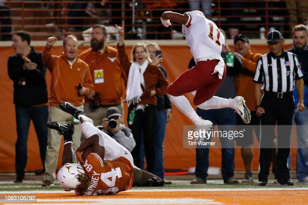 Lil'Jordan Humphrey of the Texas Longhorns scores a touchdown in the third quarter defended by Lawrence White of the Iowa State Cyclones at Darrell K...