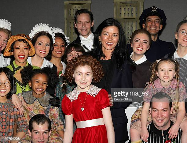 Lilla Crawford as 'Annie' and Catherine Zeta Jones pose with the cast backstage at the hit musical 'Annie' on Broadway at The Palace Theater on...