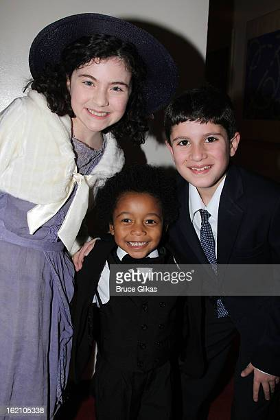 Lilla Crawford Joshua G Windley and Lewis Grosso pose backstage at 'Ragtime' on Broadway at Avery Fisher Hall on February 18 2013 in New York City