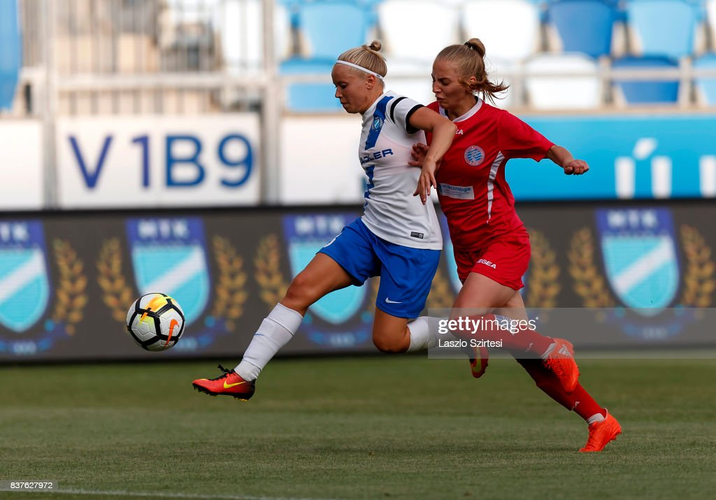 Lilla Nagy (L) of MTK Hungaria FC battles for the ball with Ugne Smitaite (R) of WFC Hajvalia during the UEFA Women's Champions League Qualifying match between MTK Hungaria FC and WFC Hajvalia at Nandor Hidegkuti Stadium on August 22, 2017 in Budapest, Hungary.
