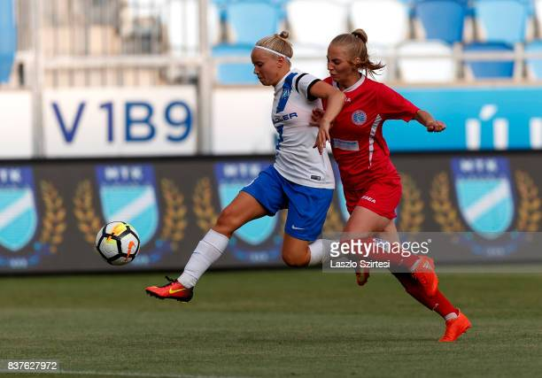 Lilla Nagy of MTK Hungaria FC battles for the ball with Ugne Smitaite of WFC Hajvalia during the UEFA Women's Champions League Qualifying match...