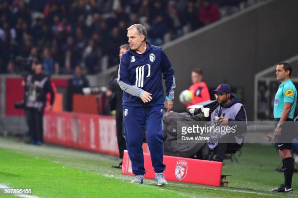 Lille coach Marcelo Bielsa throws away his coffee cup during the Ligue 1 match between Lille OSC and Olympique Marseille at Stade Pierre Mauroy on...