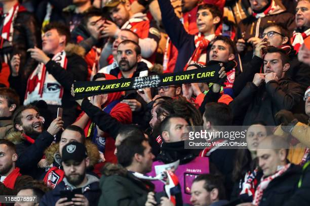 Lille fan holds up a scarf reading No One Likes Us We Don't Care during the UEFA Champions League group H match between Chelsea FC and Lille OSC at...