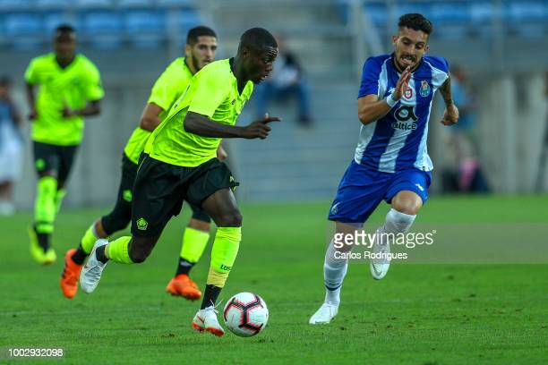 Lille forward Nicolas Pepe from Ivory Coast tries to escape FC Porto defender Alex Telles from Brazil during the match between FC Porto v LOSC Lille...