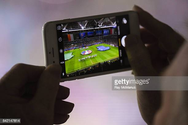 Lille France 22 June 2016 A Republic of Ireland supporter records the national anthem on their smartphone ahead of the UEFA Euro 2016 Group E match...