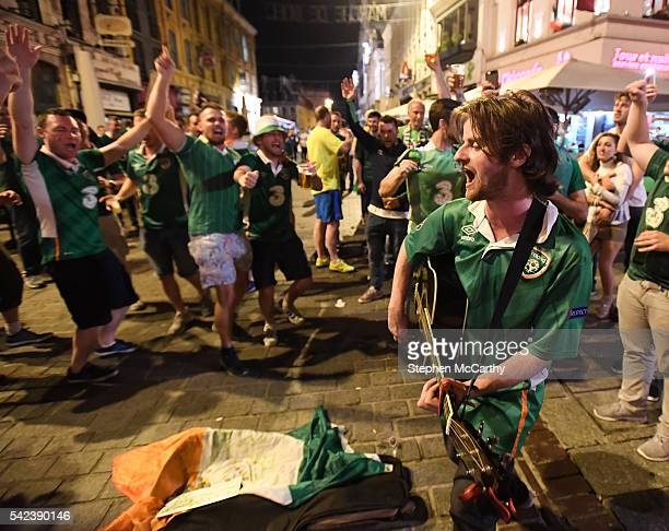 Lille France 22 June 2016 Musician Richy Sheehy from Carrignavar Co Cork entertains Republic of Ireland supporters after their victory during the...