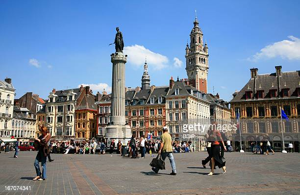 Lille france The Grand Place place Général de Gaulle with the Old Bourse in second ground on the right and the belfry classified monument in...