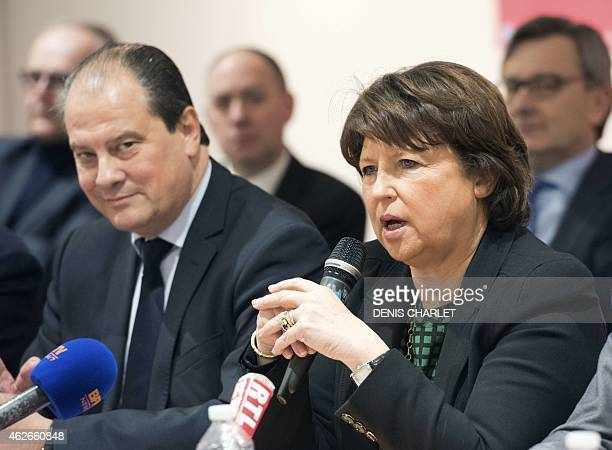 Lille Mayor Martine Aubry speaks beside French Socialist Party's First Secretary Jean Christophe Cambadelis during a press conference on January 23...