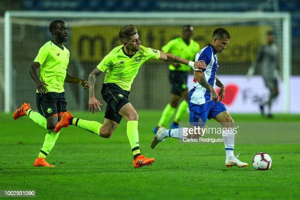 Lille midfielder Xeka tries to stop FC Porto forward Otavio during the match between FC Porto v LOSC Lille for Algarve Football Cup 2018 at Estadio...