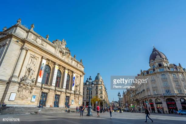 Lille Opera House on the left and locals enjoying a warm day in october on 'Place du Theatre', Lille, North of France