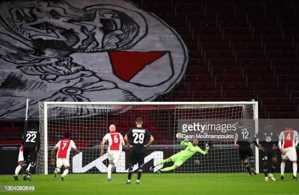Lille player Yusuf Yazıcı scores his penalty past Ajax goalkeeper Maarten Stekelenburg during the UEFA Europa League Round of 32 match between AFC...