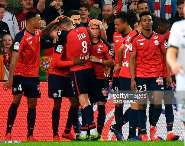 Lille players celebrate after scoring a goal during the French L1 football match between Lille and Dijon at the PierreMauroy stadium in Villeneuve...