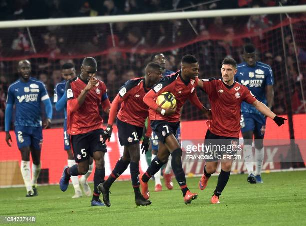 Lille' Raphael Leao is congratuled by teammates after scoring during the French L1 football match between Lille and Amiens on January 18 2019 at the...