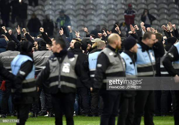 TOPSHOT Lille' supporters invade the pitch at the end of the French L1 football match between Lille and Montpellier on March 10 2018 at the Pierre...