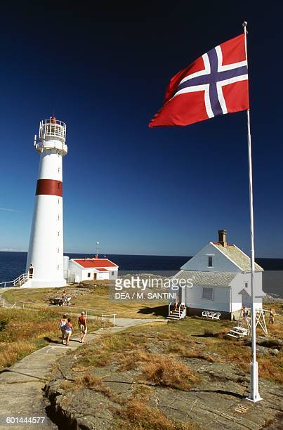 Lille Torungen Lighthouse deactivated in 1914 near Arendal with the Norwegian flag AustAgder County Norway
