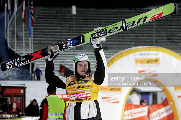 Czech Jakub Janda celebrates in the finish area after winning the World Cup ski jumping event in Lillehammer, central Norway, 04 December 2005. AFP...