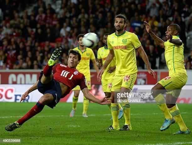Lille's Argentinian defender Renato Civelli vies with Nantes' French forward Johan Audel and Nantes' Venezuelian defender Oswaldo Vizcarrondo during...