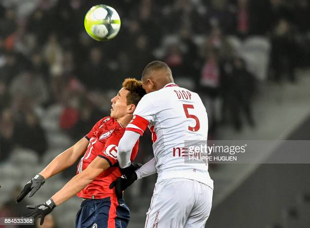 Lille's Argentinian forward Ezequiel Ponce heads the ball with Toulouse's French defender Issa Diop during the French L1 football match between Lille...
