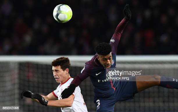 Lille's Argentinian forward Ezequiel Ponce vies with Paris SaintGermain's French defender Presnel Kimpembe during the French L1 football match...