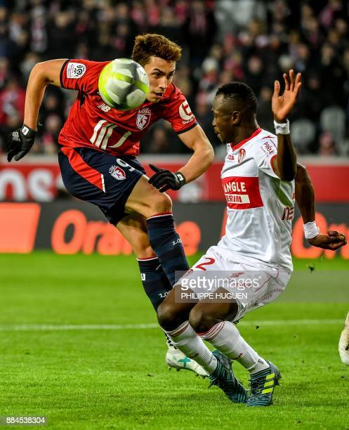 Lille's Argentinian forward Ezequiel Ponce vies with Toulouse's Guinean defender Issiaga Sylla during the French L1 football match between Lille and...