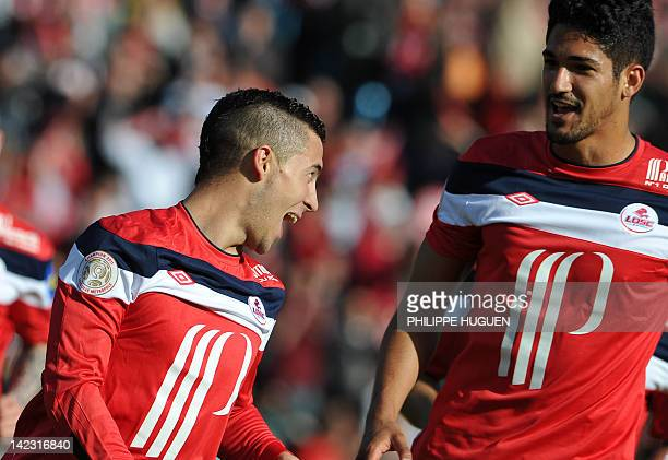 Lille's Belgian midfielder Eden Hazard is congratuled by Lille's Brazilian forward Tulio De Melo during the French L1 football match Lille vs...