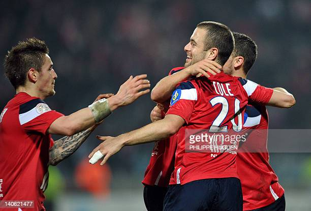 Lille's Belgian midfielder Eden Hazard is congratuled by teammates after scoring a goal during the French L1 football match Lille vs Auxerre on March...