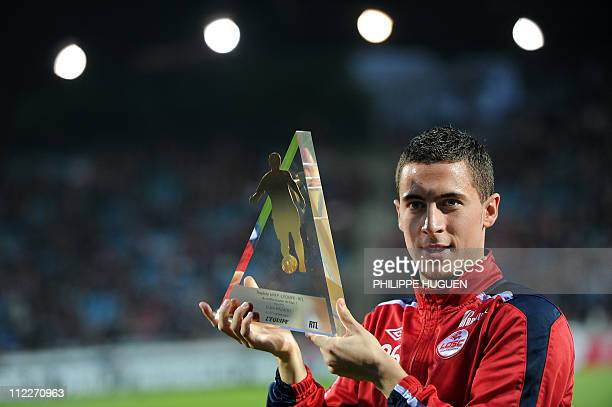 Lille's Belgian midfielder Eden Hazard poses with the L1 UNFP best player trophy of the month during their French L1 football match Lille vs Bordeaux...