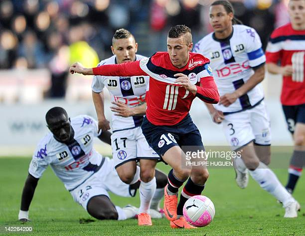 Lille's Belgian midfielder Eden Hazard vies with Toulouse's French midfielder Adrien Regattin during the French L1 football match Lille vs Toulouse...