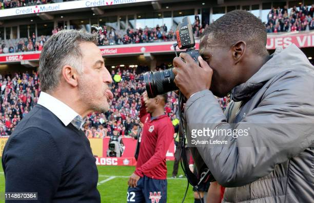 Lille's Boubakary Soulare takes pictures of coach Christophe Galtier who celebrates at the end of the Ligue 1 match between Lille and Bordeaux at...