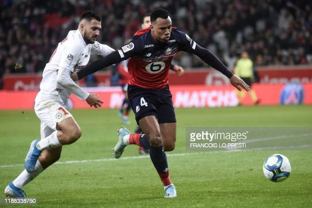 Lille's Brazilian defender Gabriel dos Santos Magalhaes fights for the ball with Montpellier's French forward Gaetan Laborde during the French L1...