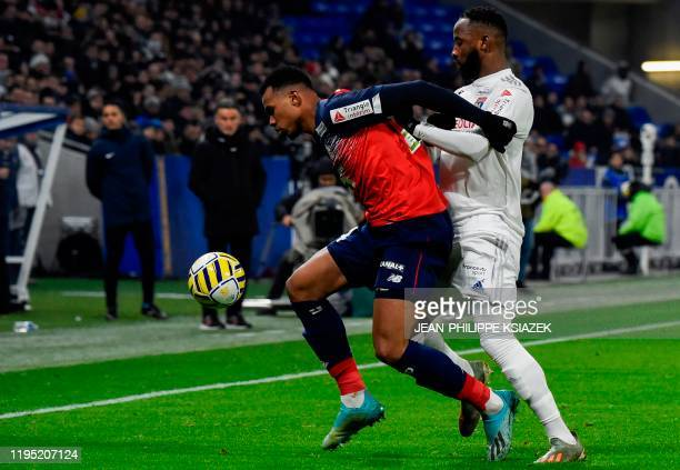 Lille's Brazilian defender Gabriel dos Santos Magalhaes fights for the ball with Lyon's French forward Moussa Dembele during the French League Cup...