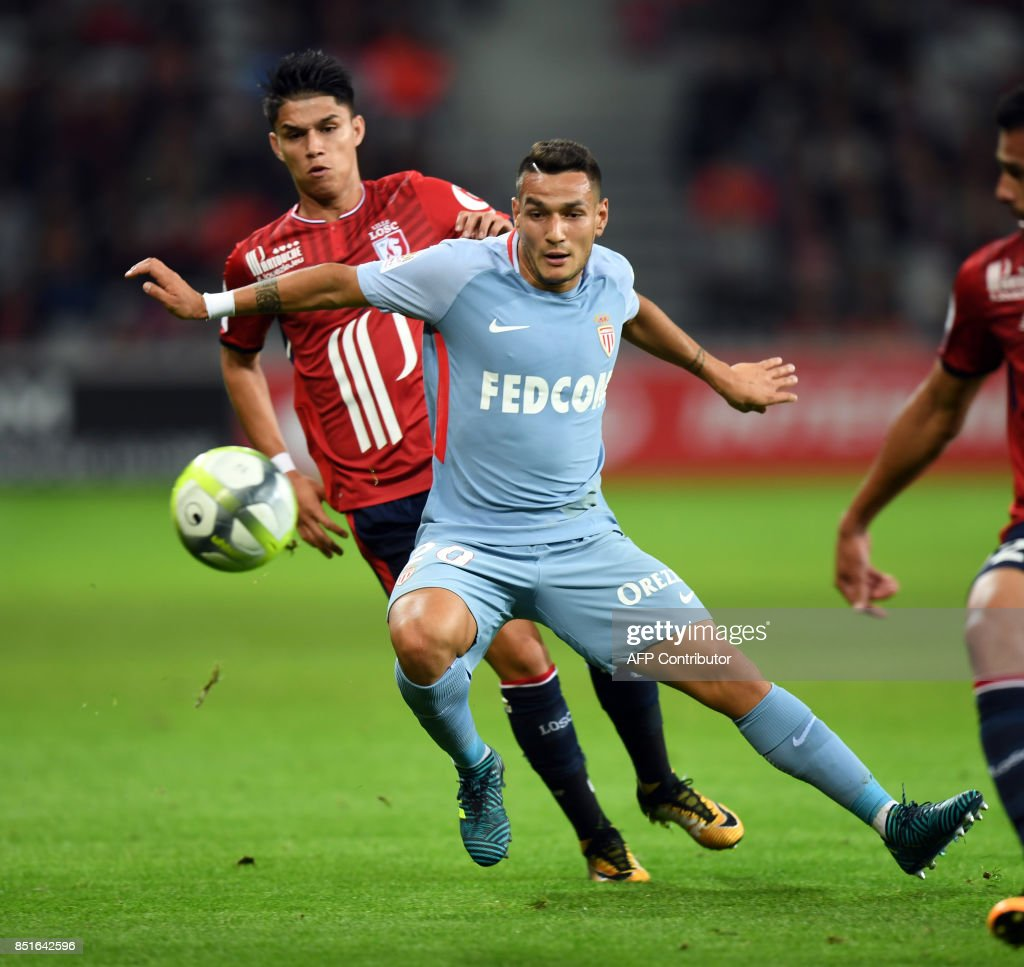 Lille's Brazilian forward Louis Araujo (L) vies with Monaco's Portuguese midfielder Rony Lopes during the French L1 football match between Lille OSC (LOSC) and Monaco on September 22, 2017 at the Pierre-Mauroy Stadium in Villeneuve d'Ascq, near Lille, northern France. /