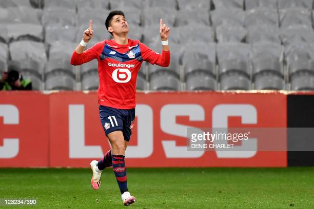 Lille's Brazilian forward Luiz Araujo celebrates after scoring during the French L1 football match between Lille LOSC and Montpellier Herault SC at...