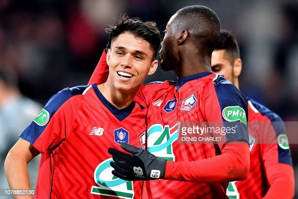 Lille's Brazilian forward Luiz Araujo celebrates with teammates after scoring during the French Cup last-64 football match between Lille LOSC and...