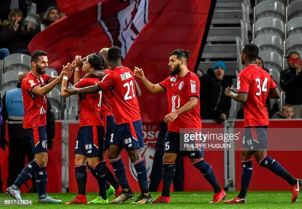 Lille's Brazilian forward Luiz Araujo is congratulated by teammates after scoring a goal during the French League Cup round of 16 football match...
