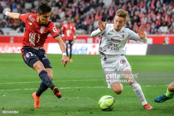 Lille's Brazilian forward Luiz Araujo kicks the ball and scores during the French L1 football match between Lille and Metz on April 28 2018 at the...