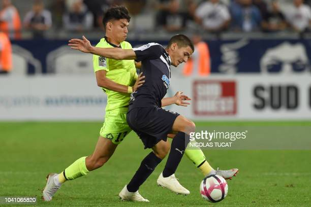 Lille's Brazilian forward Luiz Araujo vies with Bordeaux's Spanish defender Sergi Palencia during the French L1 football match between Bordeaux and...