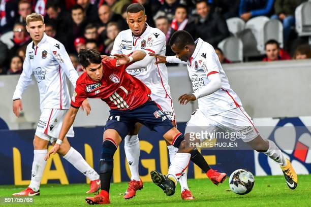 Lille's Brazilian forward Luiz Araujo vies with Nice's Ivorian midfielder Jean Michael Seri during the French League Cup round of 16 football match...