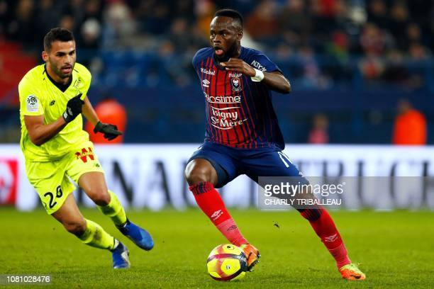 Lille's Brazilian midfielder Thiago Maia Alencar vies for the ball with Caen's midfielder Ismael Diomande during the French L1 football match between...