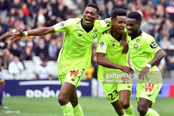 Lille's Brazilian midfielder Thiago Mendes celebrates with Lille's Portuguese forward Rafael Leao and Lille's French forward Jonathan Bamba after...