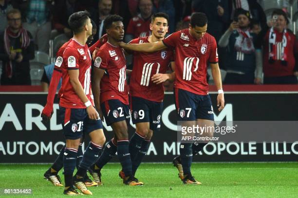 Lille's Brazilian midfielder Thiago Mendes celebrates with teammates after scoring a goal during the French L1 football match between Lille and...