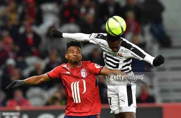 Lille's Brazilian midfielder Thiago Mendes Rennes' Congolese forward Ismaila Sarr go for a header during the French L1 football match between Lille...