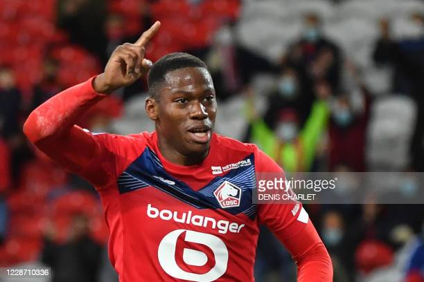 Lille's Canadian forward Jonathan David celebrates after Nantes scored an own goal during the French L1 football match between Lille and Nantes at...
