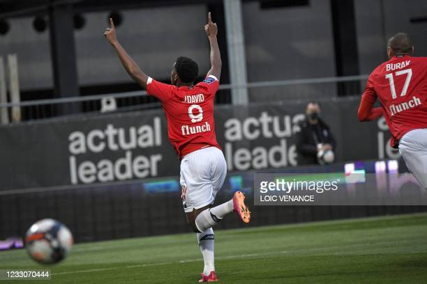 Lille's Canadian forward Jonathan David celebrates after scoring his team's first goal during the French L1 football match between Angers SCO and...