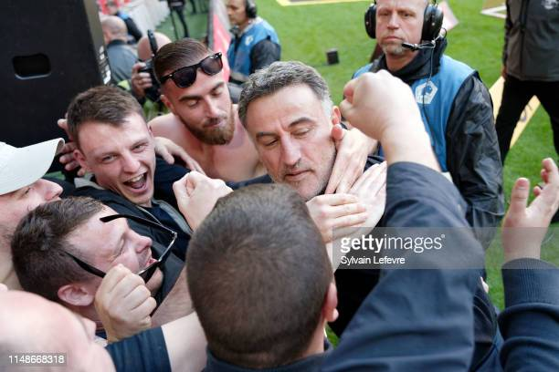 Lille's coach Christophe Galtier celebrates with fans at the end of the Ligue 1 match between Lille and Bordeaux at Stade Pierre Mauroy on May 12,...