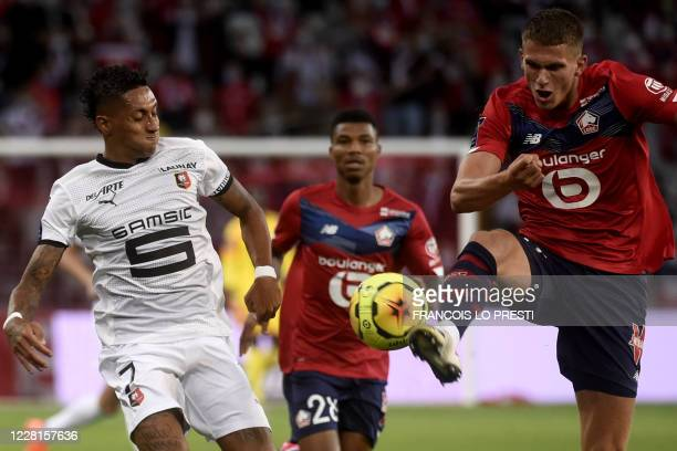 Lille's Dutch defender Sven Botman vies with Rennes' Brazilian forward Raphinha during the French L1 football match between Lille and Rennes on...