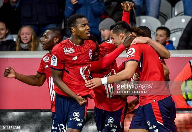 Lille's DutchMorrocan forward Anwar ElGhazi is congratuled by teammates after scoring a goal during the French L1 football match between Lille and...