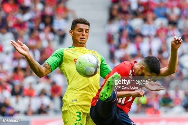 Lille's DutchMorrocan forward Anwar ElGhazi vies with Nantes' Brazilian defender Diego Carlos during the French Ligue 1 football match between Lille...
